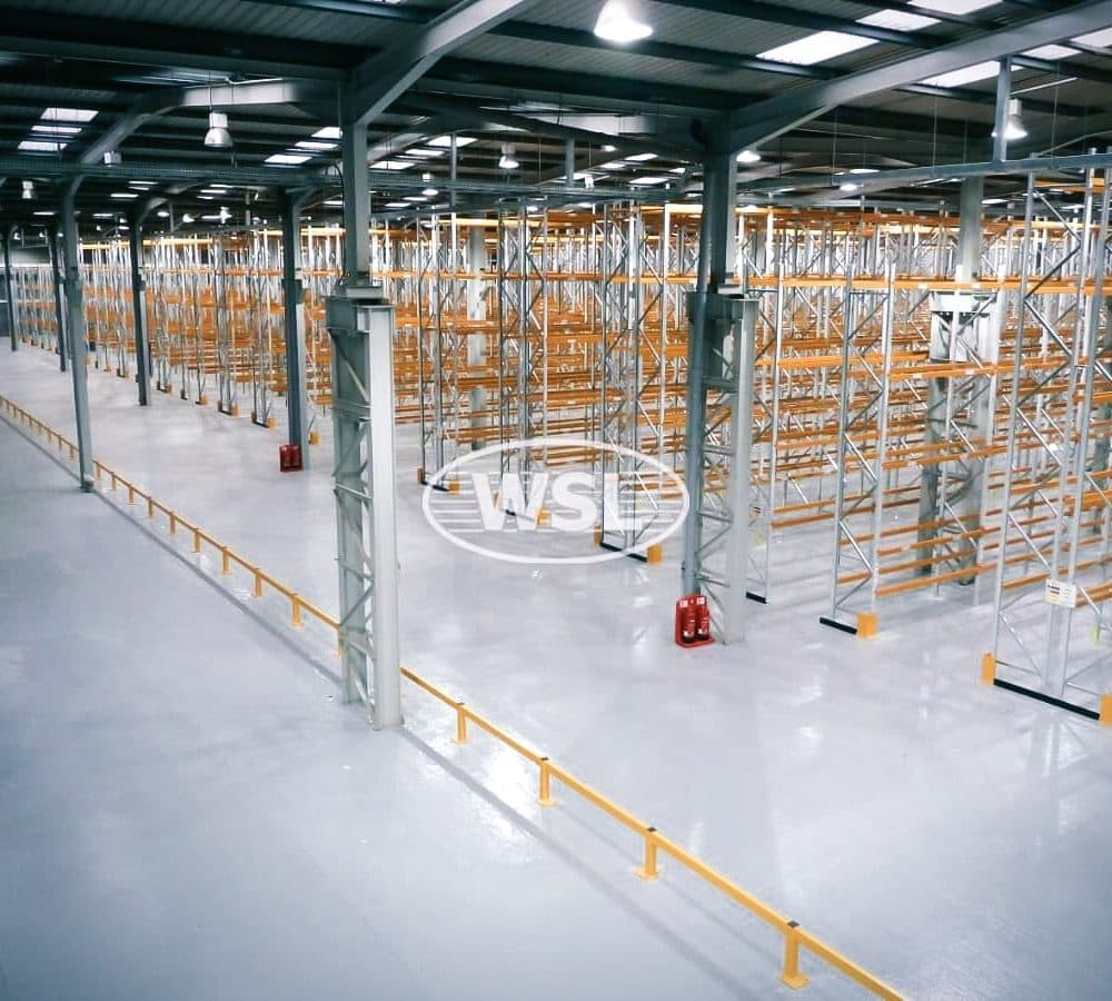 Extremely large warehouse containing multiple pallet racking systems in silver and orange finish