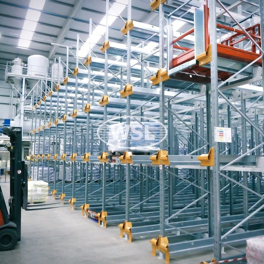 Drive-in Racking Bays with Forklift Truck Loading Pallets onto the Racks